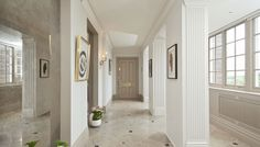 Antique mirrored alcove doubles the space in this hallway in Kensington with London Stone on woodwork. Walls are kept light to display artwork and maximise architectural features.