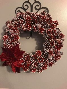 Gorgeous red and white pinecone wreath and poinsettia for Christmas or all winter long Diy Fall Wreath, Holiday Wreaths, Holiday Crafts, Pine Cone Art, Pine Cone Crafts, Pine Cone Wreath, Christmas Pine Cones, Christmas Crafts, Christmas Ornaments
