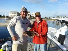 Nick gets the big flounder of the day with Mike's help. A great day of fishing.