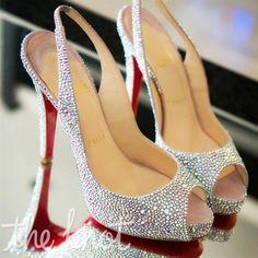 crystal-encrusted sling-back peep-toe heels.