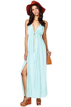 Get ready for spring in this super feminine pastel maxi dress. Features deep v-neckline, back str...
