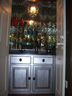 Closet Bar, Metallic Silver Cabinet, Mirrors And Mini Chrystal Chandelier.