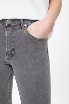 An easy slim fit, these jeans are made from stretchy grey denim with a soft washed quality. Cut to sit high on the waist and cropped just above the ankles, they are a five-pocket style with a classic zip fly and matt silver hardware.