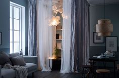 Create a cocoon in the corner of your living room using textiles, soft lighting and calming accessories.