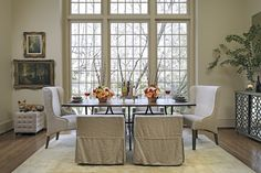 Check out the use of our short Cameron Chair 550420 to focus attention on the #table-scape in this #dining_room. The casters make it easy to pull from under the table and the top stitch skirt adds feminine elegance only from #Gabby. www.gabbyhome.com  www.nestfinegifts.com