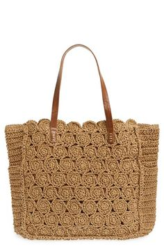 Free shipping and returns on Straw Studios Crochet Tote at Nordstrom.com. Perfect for hauling goods from the farmer's market, this spacious warm-weather tote is crocheted from natural straw and is outfitted with smooth handles.