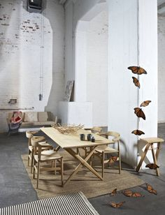 This space is beautiful and raw. The warehouse space, with the concrete floor and light timber furniture works really well together.
