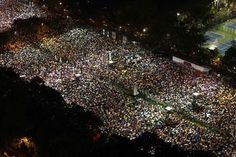 Tens of thousands of people carry umbrellas in the rain take part in a candlelight vigil at Hong Kongs Victoria Park June 4, 2013, to mark the 24th anniversary of the military crackdown of the pro-democracy movement at Beijings Tiananmen Square in 1989. REUTERS-Bobby Yip