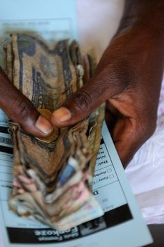 CGAP 2011 Microfinance Photo Contest: A client reimburses part of a microfinance loan that she received from Fonkoze in Limbe, Haiti.