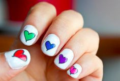 These little transfers nail decals are made from my own illustrations of colorful hearts. There are 42 water transfers that blend in perfectly with clear, pale or white nail polish. #rainbowhearts #hearts #naildecals #nails #obscuraoutfitters #cute #nailideas