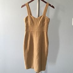 Banana Republic retro glam dress, size 0 An elegant Banana Republic gold dress that's perfect for your upcoming date night or special occasion! Material is slightly thicker with 10% wool to keep you warm just enough to ask your date to snuggle. Heart-shaped neckline, knee-length and lined. Size 0 but fits a little loose. Worn only once to a winter wedding. Banana Republic Dresses Prom