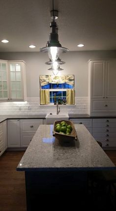 Kitchen designed, purchased and assembled by homeowner utilizing IKEA products. Cabinets are Bodbyn, sink is DOMSJÖ, pendant lights above island are OTTAVA, quartz is Atlantic Salt and Concrete by Caesarstone. Faceted subway tile purchased at Lowe's.