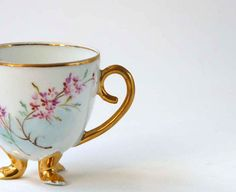 metal footed tea cups | Antique Eggshell tea cup, footed with floral spray and gilt accents