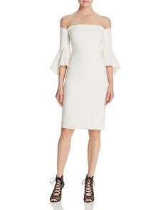 Laundry by Shelli Segal's dress is fit to flirt with an off-the-shoulder neckline and dramatic flounced sleeves.   Self & lining: polyester/spandex   Dry clean   Imported   Fits true to size, order yo
