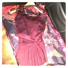 Donna Karan tunic / skirt set size Petite small Beautiful and elegant eggplant color skirt and tunic set looks great with a belt and pearls.  Stretch material, pleated skirt bottom Donna Karan Dresses