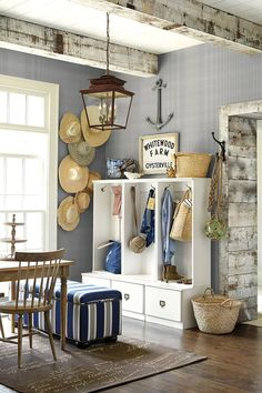 hats on the wall are cute; also like the anchor and bench upholstery and the glass ball in rope :)