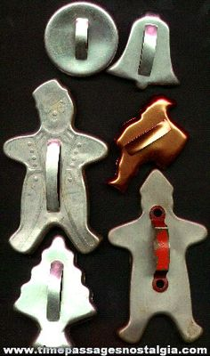 old metal cookie cutters 1940-1960s .. remember helping mom at Christmas making shortbread cookies with cutters just like these. aww nice memories!