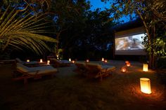 Amazing Exclusive Resort In Maldives: Gili Lankanfushi: Gili Lankanfushi Resort Jungle Cinema Outdoor Design With Lounge Chairs Lamps Beach Big Screen Surounding Tree Ideas ~ cienmaneras.com Accessories Inspiration