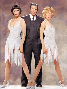 Catherine Zeta-Jones (Velma Kelly), Renee Zellweger (Roxie Hart), and Richard Gere (Billy Flinn) in their finale costumes from Chicago