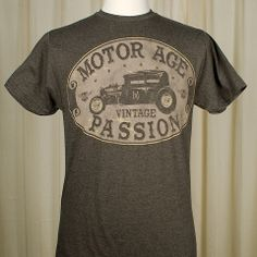 Vintage Passion T Shirt:This is a great basic T. It's a mens T shirt in heathered dark brown with a front print of a car and Motor Age Vintage Passion. The back has the Motor Age winged logo at the collar. $24.00