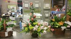 Cymbidium orchid and rose arrangement with green hydrenga and kiwi vine