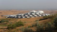 The Desert Lotus Hotel in Xiangshawan Desert, also called Resonant Sand Gorge in Ordos, Inner Mongolia Autonomous Region, China, on July In China, Chinese Architecture, Amazing Architecture, Futuristic Architecture, Organic Architecture, Hotels And Resorts, Best Hotels, Lotus Belle Tent, Desert Resort