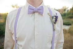 Between the purple suspenders and bowtie and the lovely lavender-larkspur boutonniere, we think this guy is nailing the wildflower look! Bowtie And Suspenders, Bowties, Groom Attire, Groom And Groomsmen, Groom Suits, Wedding Suits, Wedding Attire, Vestido Color Lila, Quince Dresses