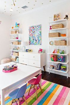 10 Amazing Colorful Playroom Ideas That You'll LOVE, girl playroom design with kid craft table and bookshelves for kid toys, kid organization in playroom decor or bonus room design