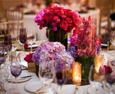 Vibrant Floral Centerpieces    Photography: Jasmine Star Photography   Read More:  http://www.insideweddings.com/weddings/romantic-garden-wedding-in-beverly-hills-california/450/