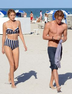 Gigi Hadid with Cody Simpson on the beach in Miami in a Solid & Striped bikini. See all of the model's best looks.