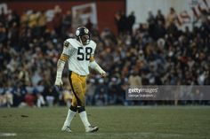 Linebacker Jack Lambert #58 of the Pittsburgh Steelers looks on from the field during a game against the Baltimore Colts at Memorial Stadium on November 13, 1983 in Baltimore, Maryland. The Steelers defeated the Colts 24-13.