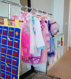 Rather than tossing dress up clothes in a play room bin or cluttered drawer, try hanging each outfit on a kid-height clothing rack. #organization