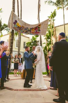 The groom lifts his beautiful bride's delicate lace veil | Image by Concept Photography