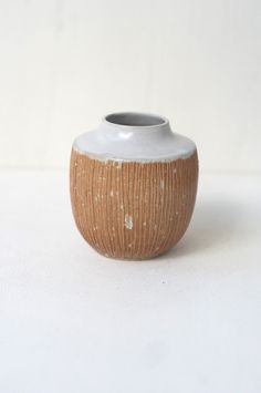 Malinda Reich Vase no. 031 - A small vase with a white-glazed neck and textural carving into its unglazed sides. The right size for a few wildflower stems.Friend and neighbor Malinda Reich' - from QUITOKEETO.com