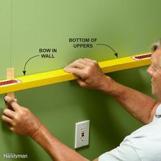 Shim Large Bows Most of the time you can shim the cabinets as you go, but if there's an extreme bow in the wall (more than 3/8 in.), shim it out before you hang the cabinet. If you don't, you may accidentally pull the back off the cabinet while fastening it into place.