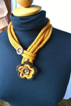 Another scarf shaped crochet necklace is here. In this one we have refrained from some unwanted additions and we have deliberately tried to keep is as simple as possible and very eye catching. We simply added a couple of buttons and in the rest part there are just multi layered strings made with crochet.