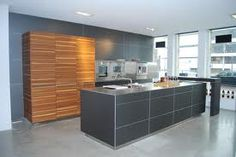 Bulthaup kitchen with gray aluminum fronts on the island.