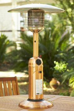 "Tabletop Propane Patio Heater, 13""Hx21""W, COPPER by Home Decorators Collection. $98.99. Some assembly required.. Uses a 1 lb. disposable propane bottle, not included.. 34.75""H x 21"" diameter hood.. The Tabletop Propane Patio Heater will add warmth and ambience to your outdoor dining. Lightweight and portable, you can also place it on a patio side table and stores easily when not in use. Create the perfect setting with our outdoor accessories; order today.This 10,000 B..."