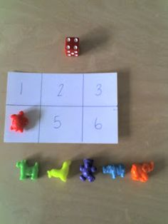 Easy number game-Divide index card into 6 sections, roll die, if you roll a 1/cover 1, etc.
