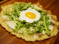 The potato crust on this white pizza gives hash browns a European flair, while the arugula brings much-needed greenery to the table.