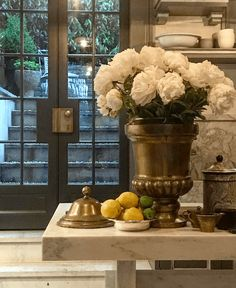 Class (is not an) act. Steven Gambrel gorgeous vignette - peonies- brass urn-French doors- kitchen definitely not bland decor Interior Design Kitchen, Interior And Exterior, Kitchen Decor, Kitchen Vignettes, Timeless Kitchen, Gambrel, Canopy Design, Bistro Chairs, Winter House