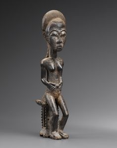 Seated female Baule figure, Ivory Coast.  Height 46 cm.  At TEFAF Maastricht 2016, Bernard de Grunne presents 'Seated Baule figure as Thrones of the Spirits'. A rare collection of 18 museum-quality pieces from the Baule tribe in Central Ivory Coast.