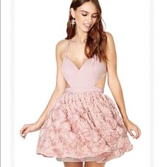 Nastygal (blush/pink/mauve) Rose Dress NWT, tags still attached. Never got a chance to wear it and now it's too big to wear. Bought full price $150+ and the dress sold out. Thinking of keeping it and getting it fixed in but not sure unless someone wants to buy. NO LOW BALLERS PLS! Thanks Nasty Gal Dresses