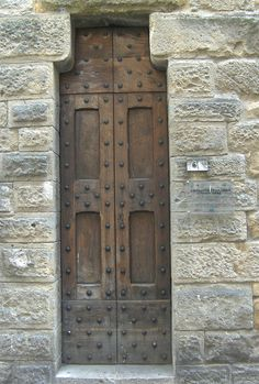 Italy  - cool door shape. I have been to Volterra. It was a rainy gray door. Kind of felt like this door scene.