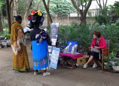 Public witnessing in Arusha, Tanzania. The lady is a sock-peddler and is carrying a bundle of socks on her head.