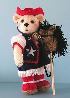 "Texas Rose (12""(30cm)Tall) and Pronto the Horse ~ Amigurumi Free Download Pattern.  The pattern booklet contains 20 pages, with lots of detail. Color photos of the completed bear (The clothing is removable, with the exception of the boots) and hobby horse are provided. ."