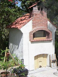 Wood oven with meat cold smoker.