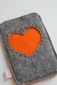 Felt cell phone cover or case for iPhone or smartphone - Grey with orange heart. €17.50, via Etsy.