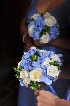 blue hydrangea, white roses, green hypericum berries