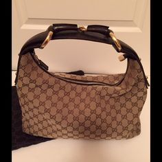 Authentic Gucci Monogram Horsebit Hobo Dark Brown This is an authentic Gucci monogram Horsebit hobo in dark brown. This stylish classic is beautifully crafted of traditional Gucci GG monogram canvas. This bag is in very good condition ideal for day and evening. Gucci Bags Hobos